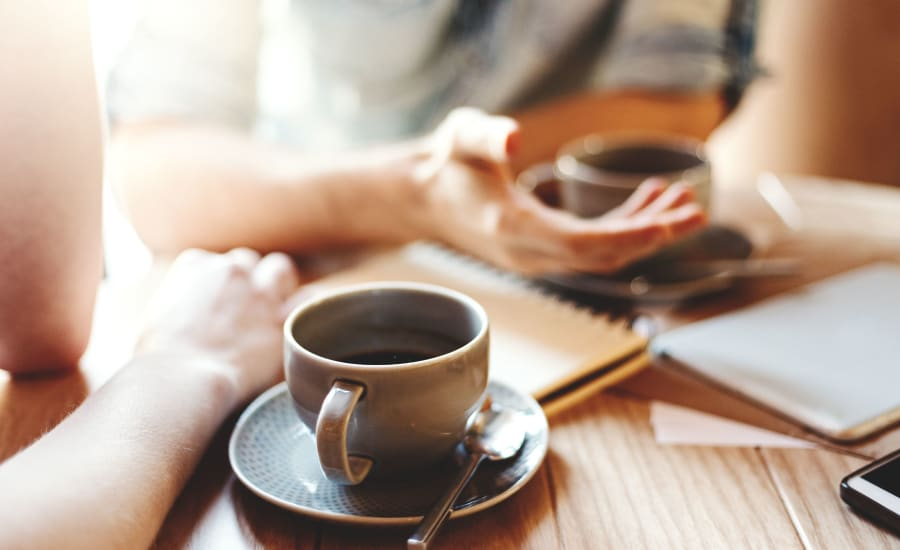 Resident starting the day with hot coffee in a local cafe near Residences at 8 East Huron in Chicago, Illinois
