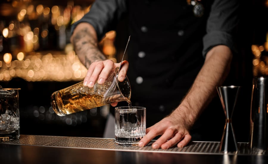 Bartender mixing a drink near Residences at 8 East Huron in Chicago, Illinois