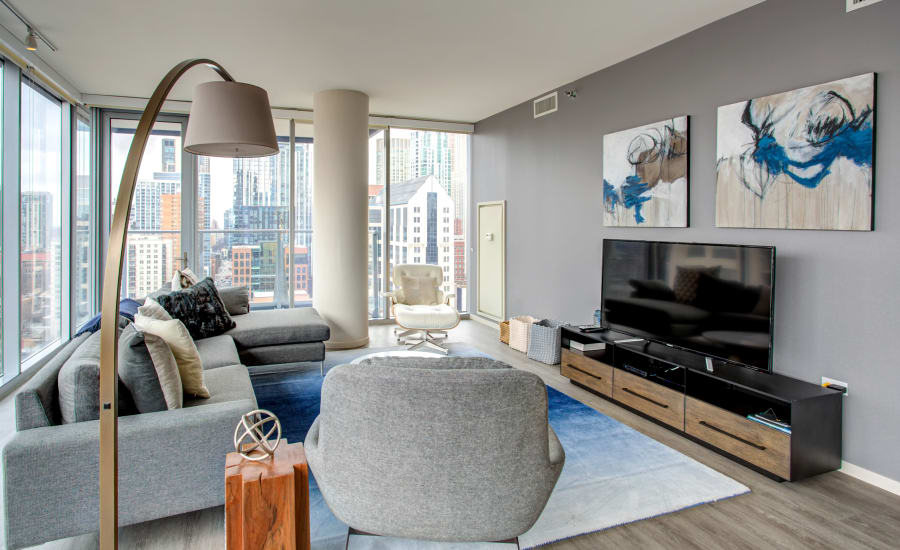 Residences at 8 East Huron's spacious living room a great view of Chicago, Illinois
