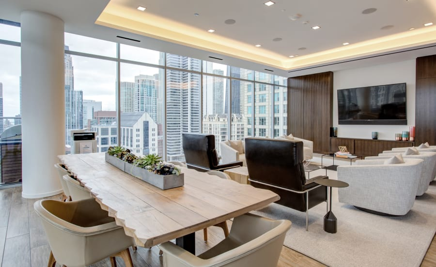 Indoor community lounge with a Smart TV at Residences at 8 East Huron in Chicago, Illinois