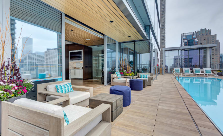 Poolside lounge chairs at Residences at 8 East Huron in Chicago, Illinois