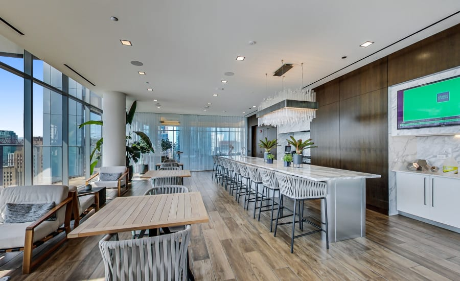 Community kitchen and lounge at Residences at 8 East Huron in Chicago, Illinois