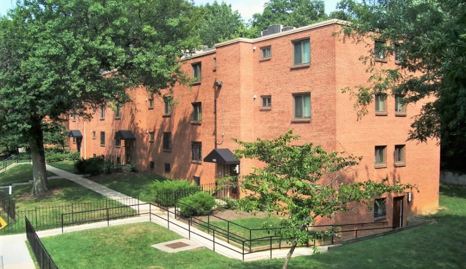 Large brick building and walkways at Frederick Douglass Apartments