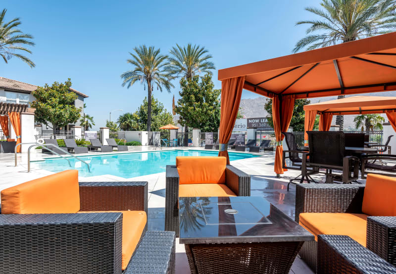 Outdoor firepit pool side at Vista Imperio Apartments in Riverside, California