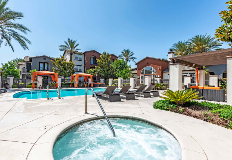 Enjoy the hot tub at Vista Imperio Apartments in Riverside, California
