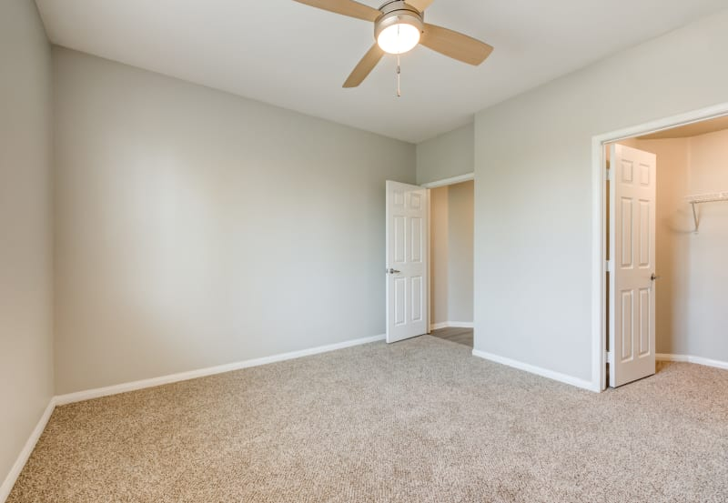 Bedroom with bathroom at Vista Imperio Apartments in Riverside, California