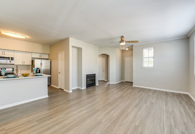 Hardwood flooring in living room at Vista Imperio Apartments in Riverside, California