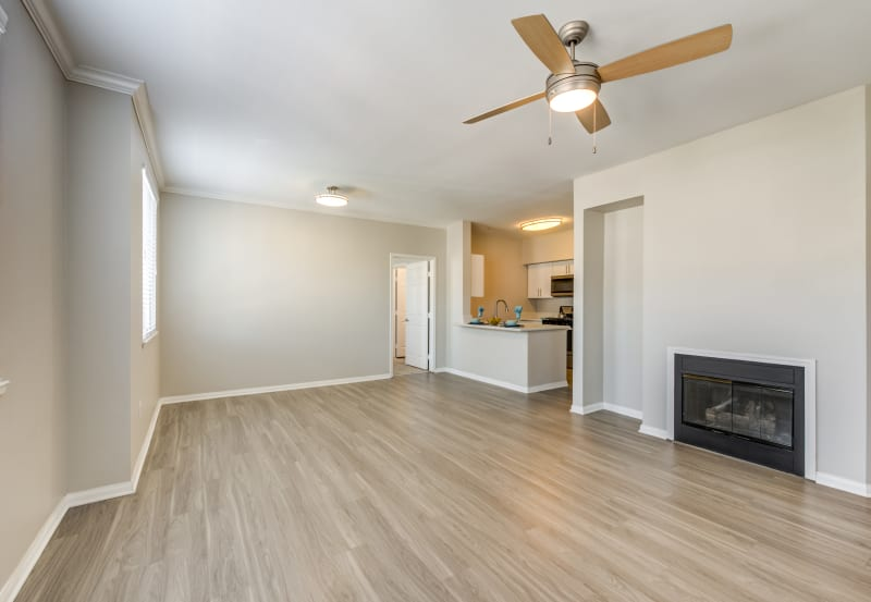 Fireplace and hardwood flooring at Vista Imperio Apartments in Riverside, California