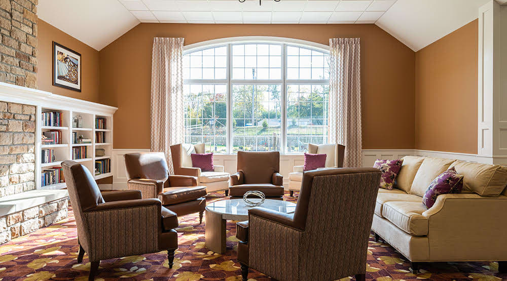Seating area with a large window looking outside at Randall Residence of Centerville in Centerville, Ohio