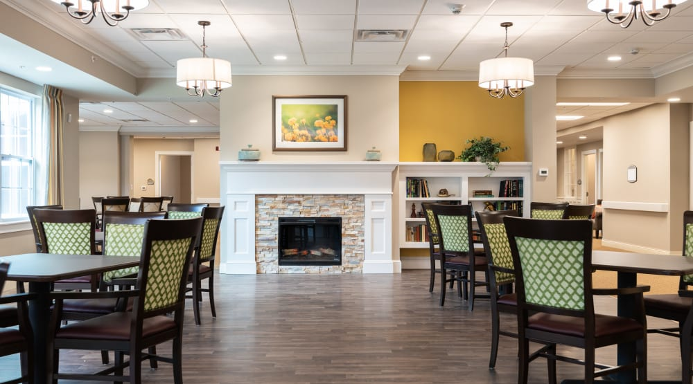 Dining hall with hardwood floors at Randall Residence of Centerville in Centerville, Ohio
