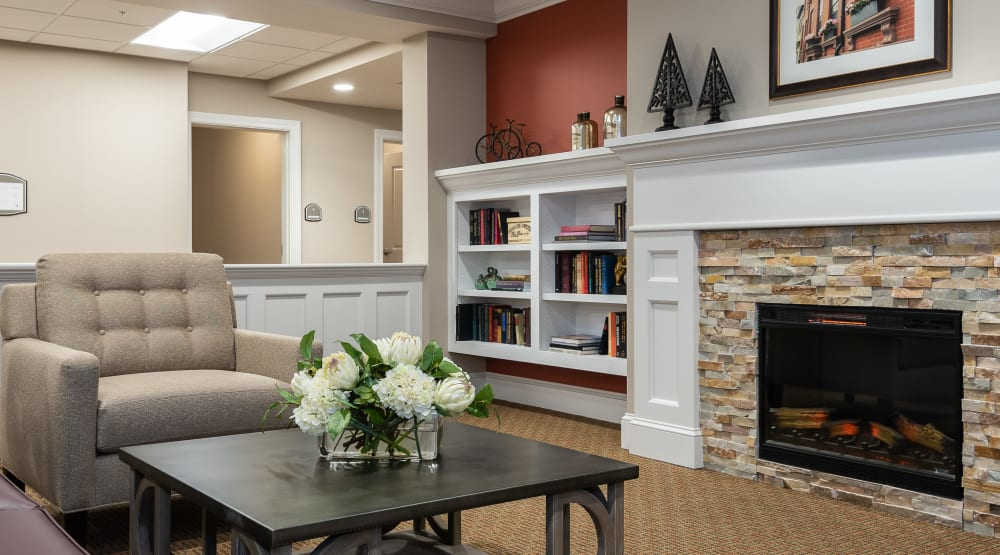 Lounge with a bookshelf and fireplace at Randall Residence of Centerville in Centerville, Ohio