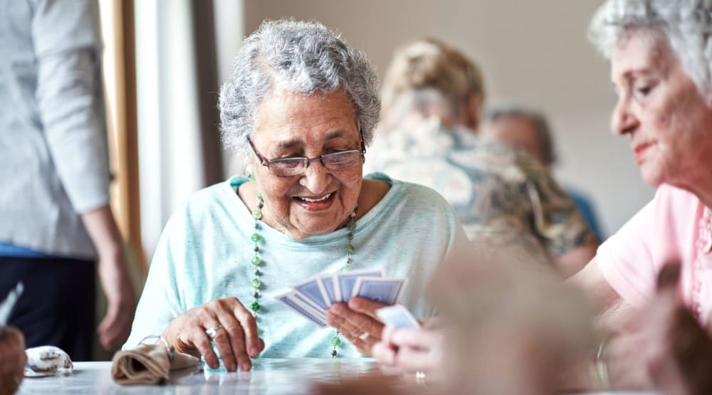 Resident playing cards with other residents at Randall Residence of Sterling Heights in Sterling Heights, Michigan