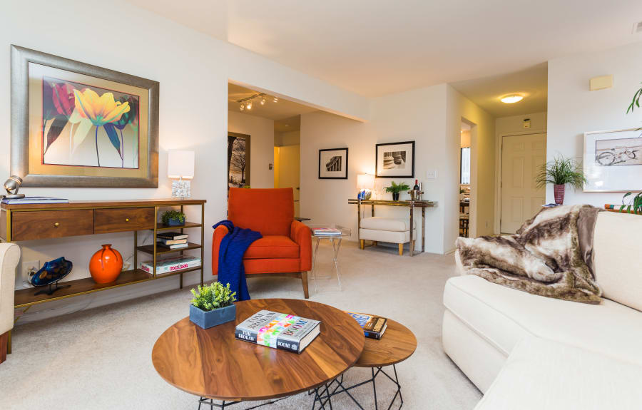Well-lit living room at Fairmont Park Apartments in Farmington Hills, Michigan