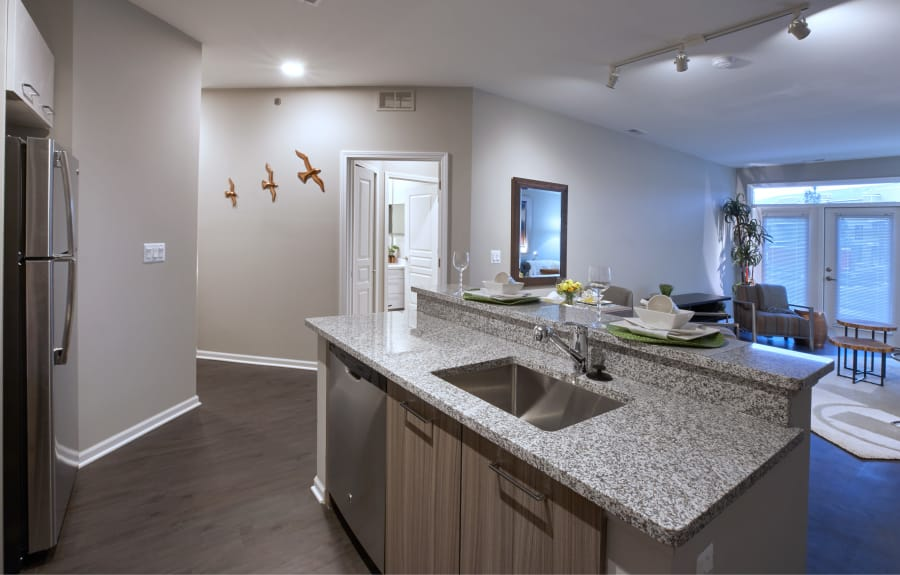 Hardwood floors and granite countertops in the kitchen at Five Points in Auburn Hills, MI