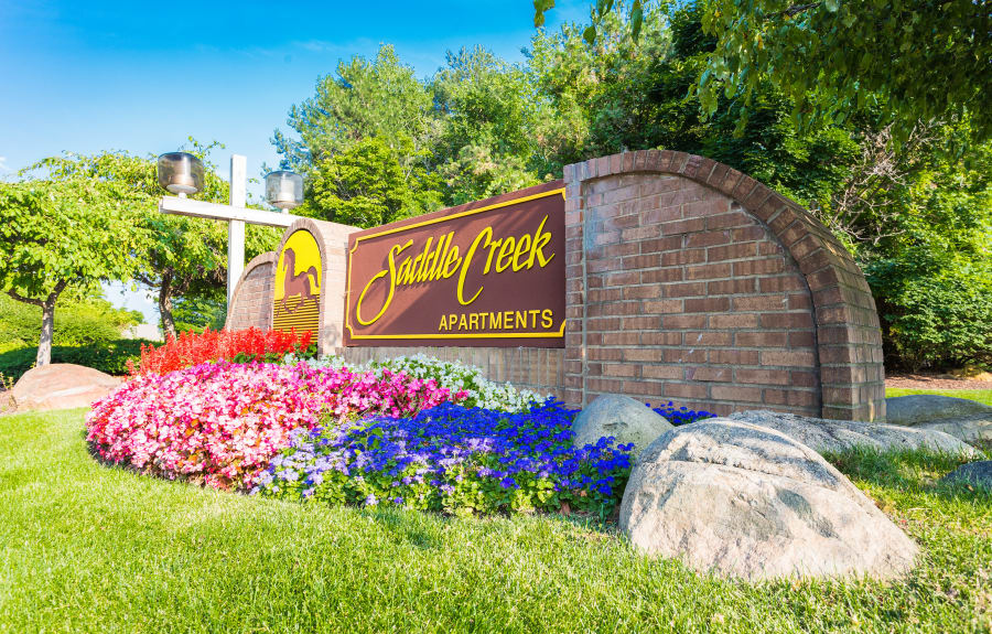 Landscaped entry at Saddle Creek Apartments in Novi, Michigan