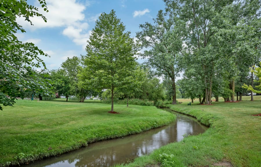 Fabulous landscape at Creek Club Apartments in Williamston, Michigan