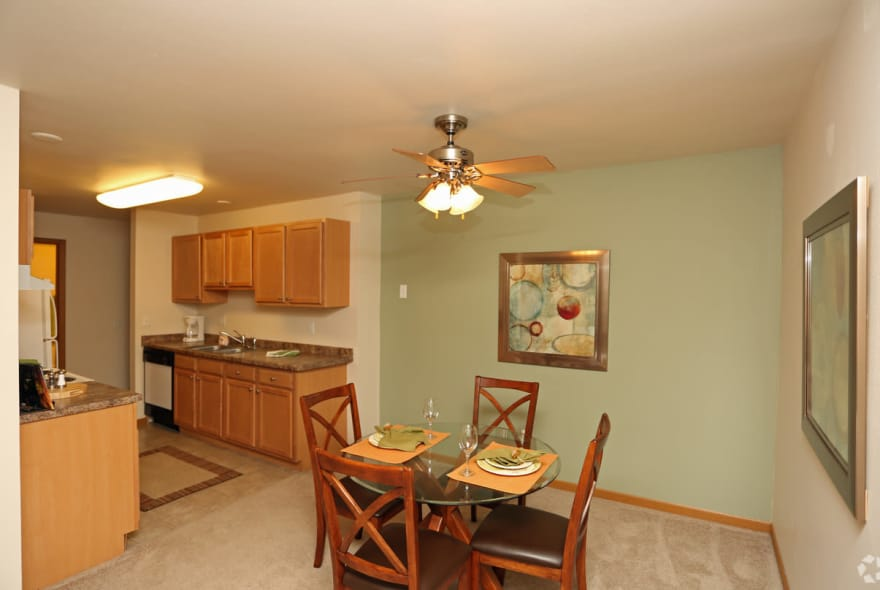 Enjoy dinner with the family in your dining room at Sun Valley Apartments