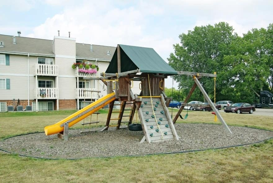 Enjoy family time at the playground at Sun Valley Apartments