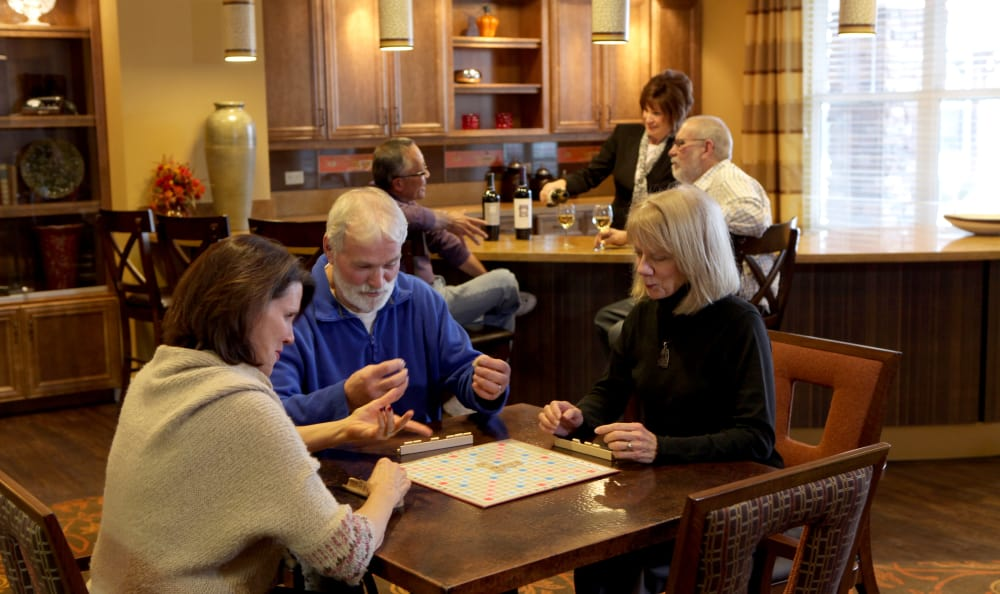 Gather with family and play cards at The Retreat at Sunny Vista