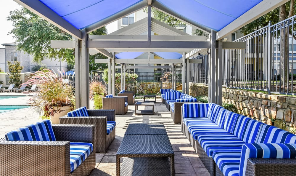 Luxurious shaded outdoor seating area at Abbey at Vista Ridge Apartments