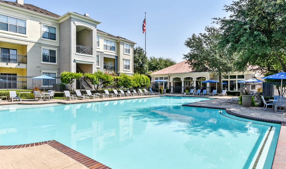 Swimming pool area at Abbey at Vista Ridge Apartments on a beautiful day