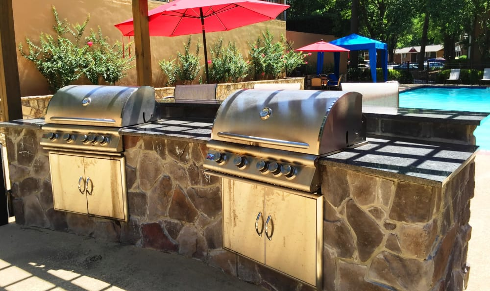 BBQ stations by the pool at Abbots Glen in Norcross