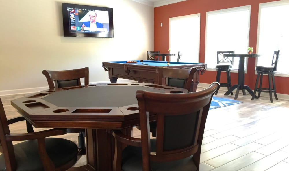 Get a friendly game of cards going with your new friends and neighbors in the clubhouse at Abbots Glen