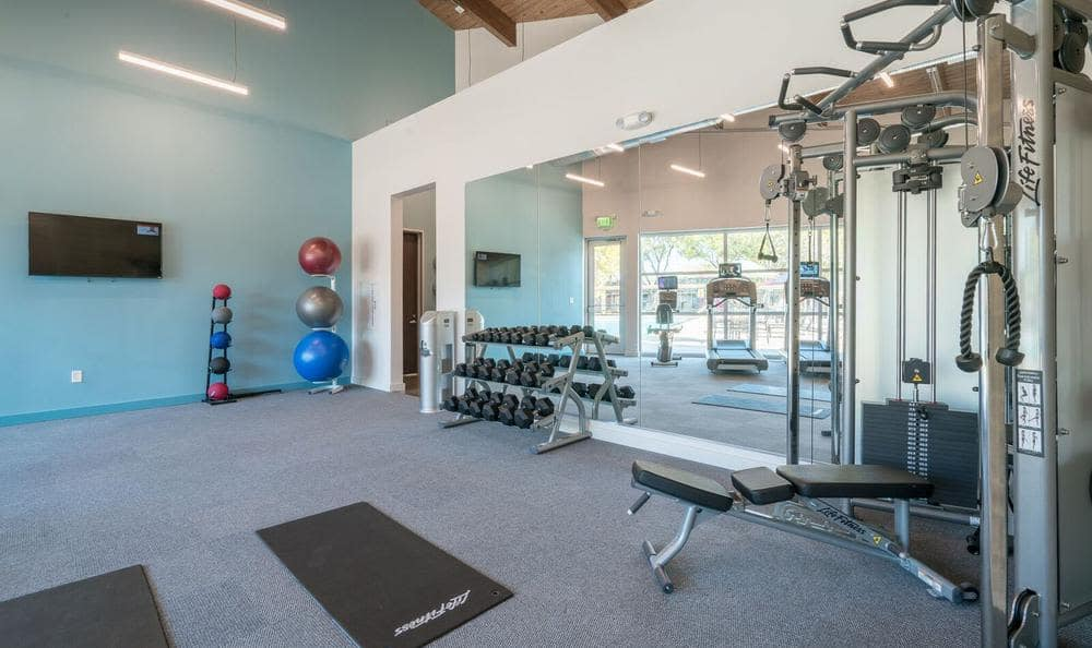 Beautiful fitness center at Villages at Parktown Apartments in Deer Park, TX