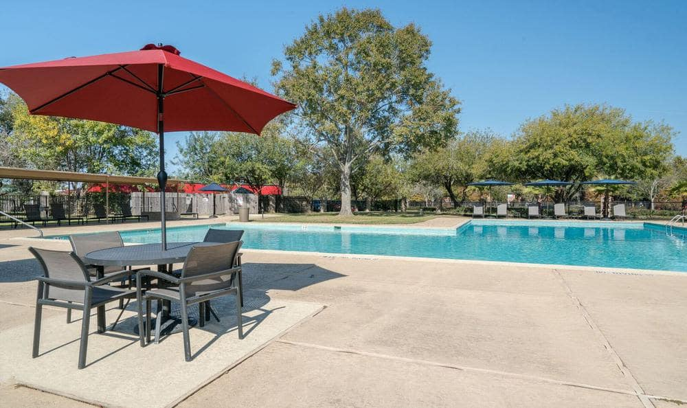 A swimming pool that is great for entertaining at apartments in Deer Park, TX