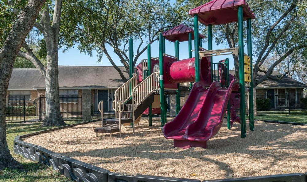 Beautiful Playground at Villages at Parktown Apartments in Deer Park, TX