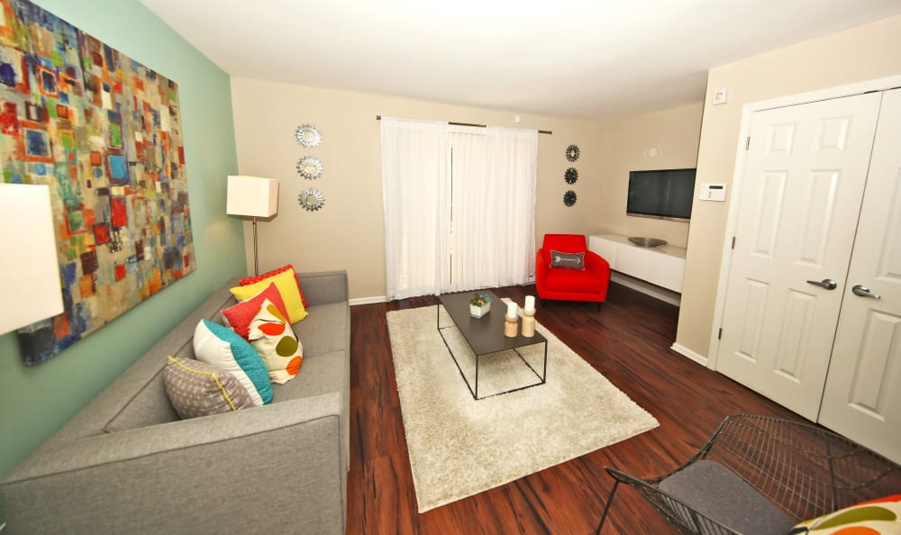 Open living room with hardwood floors at The Broadway at East Atlanta