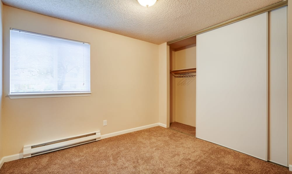 Spacious master bedroom with plenty of closet space in model home at Arbor Chase Apartment Homes