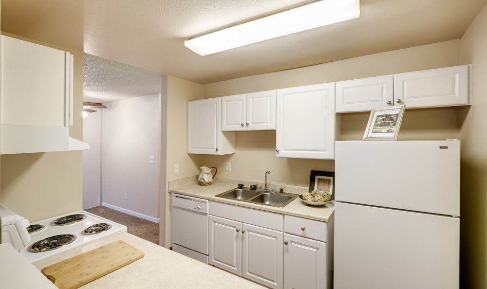 View of the modern kitchen in model apartment at Arbor Chase Apartment Homes