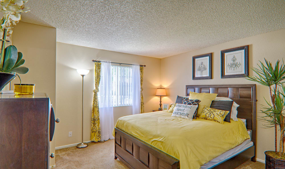 Spacious and bright bedroom in model home at Cordova Park Apartment Homes in Lancaster, CA