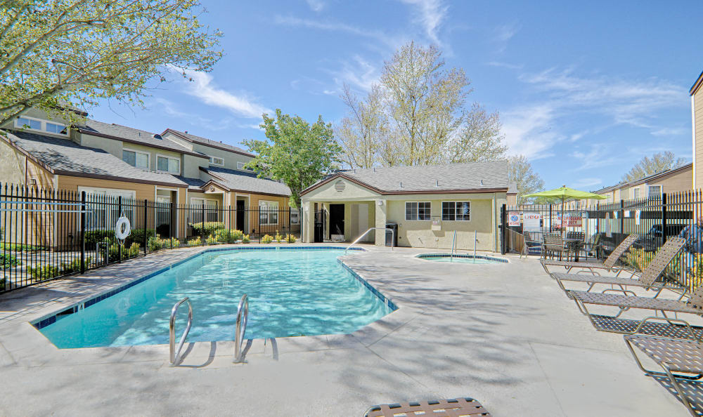 Sunny day at the pool at Cordova Park Apartment Homes in Lancaster, CA