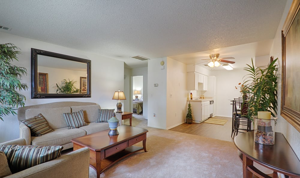 Well-decorated living room in model home at Country Hills Apartment Homes