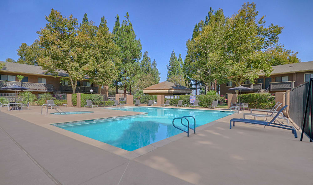 Swimming pool area at Creekside Village Apartment Homes in San Bernardino, CA