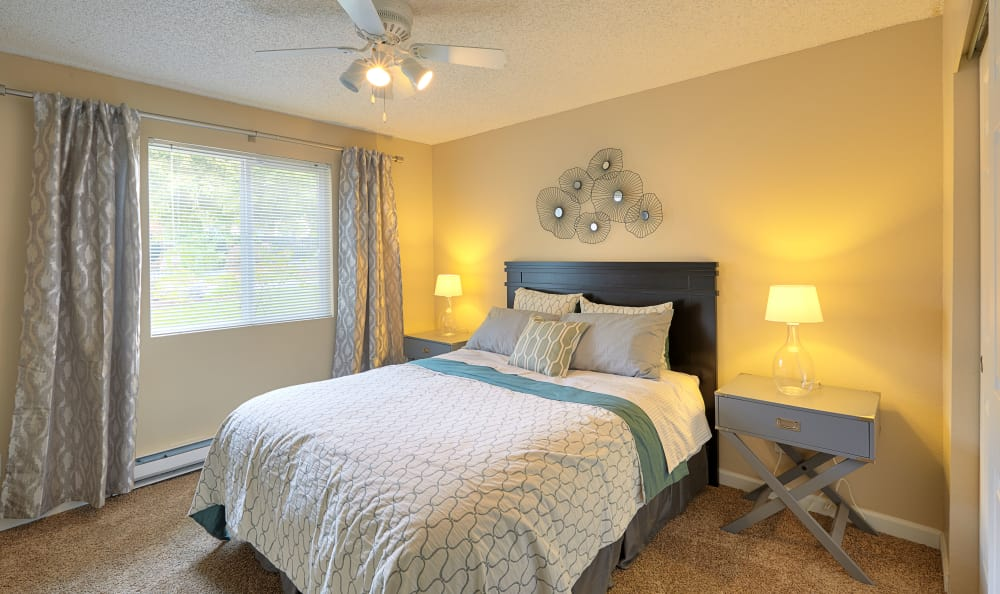Bright and cheery bedroom in model home at The Boulevard at South Station Apartment Homes