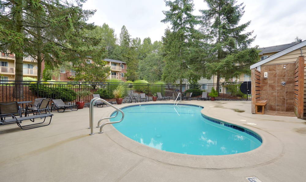 Swimming pool area at The Boulevard at South Station Apartment Homes in Tukwila, Washington