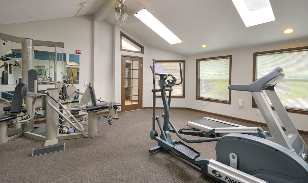 Well-equipped fitness center at The Boulevard at South Station Apartment Homes in Tukwila, Washington