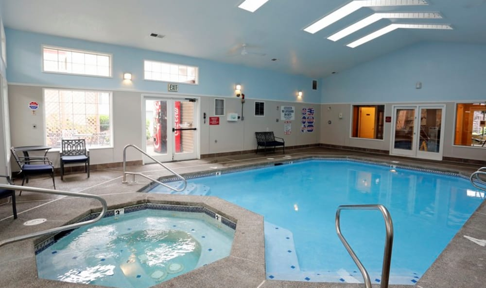 Indoor swimming pool area at Discovery Landing Apartment Homes in Burien, WA