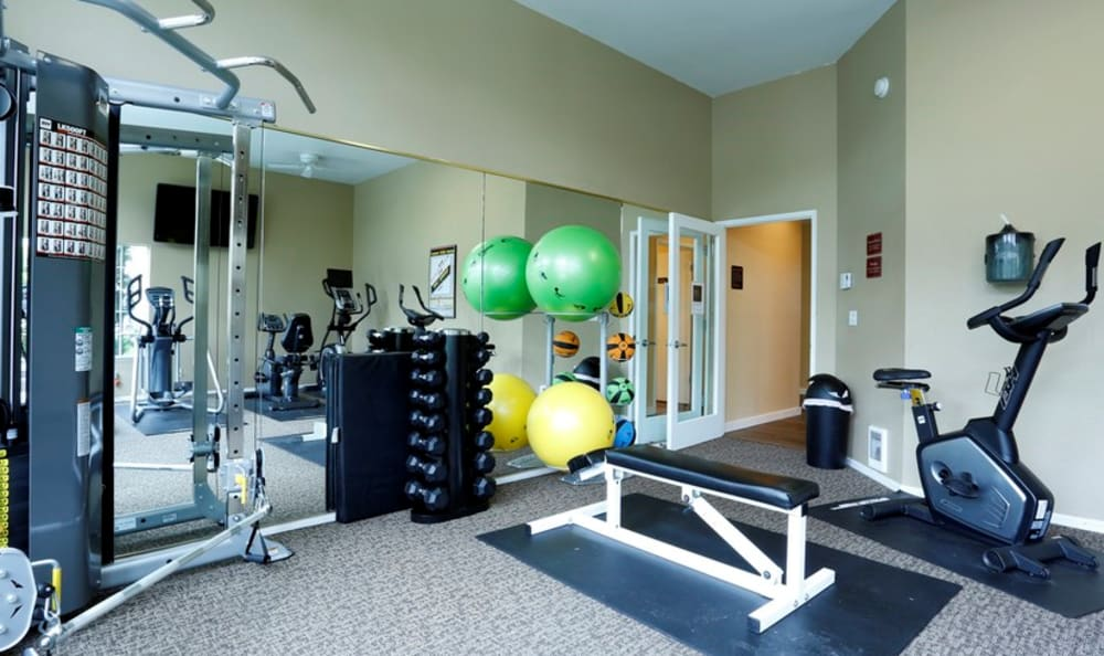 Well-equipped fitness center at Discovery Landing Apartment Homes in Burien, WA