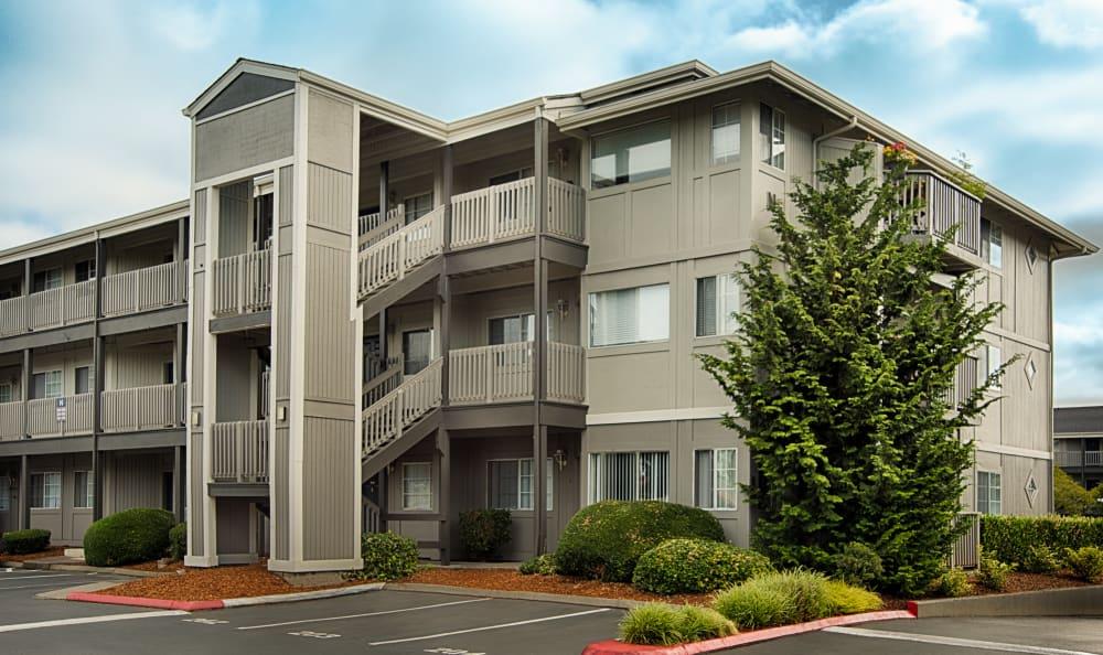 Exterior of units and parking lot at Bridge Creek Apartments in Vancouver, Washington