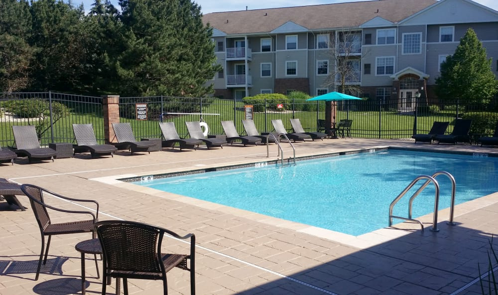 Beautiful outdoor swimming pool at The Preserve at Osprey Lake on a sunny afternoon