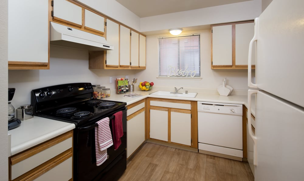 A kitchen at Bennington Apartments with ample storage space