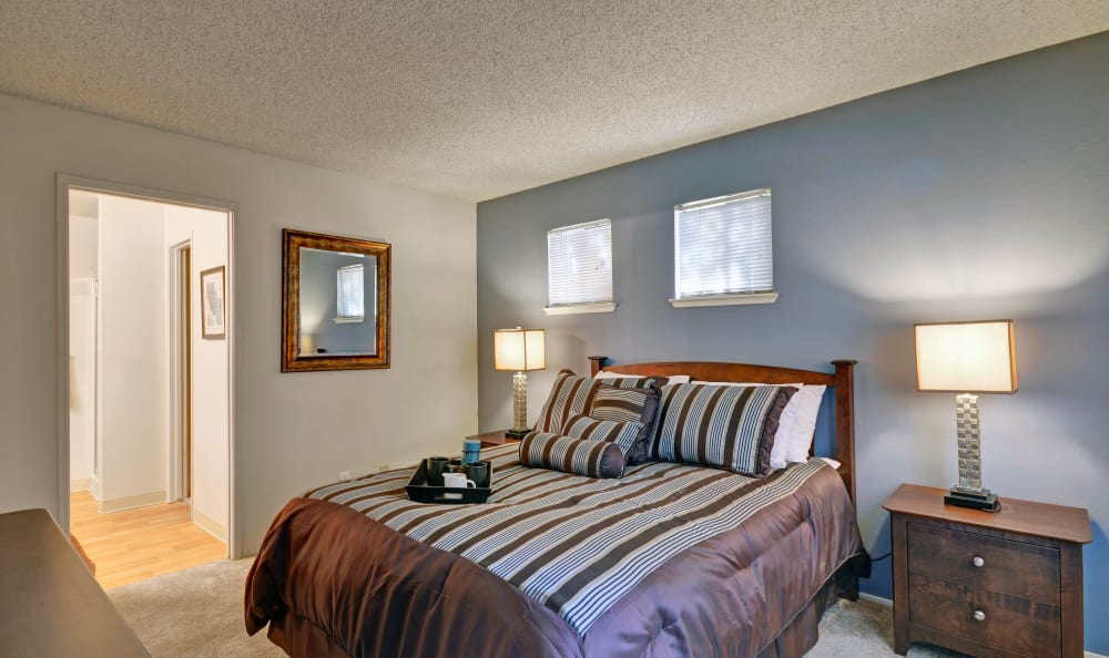 A comfy master bedroom at Bennington Apartments
