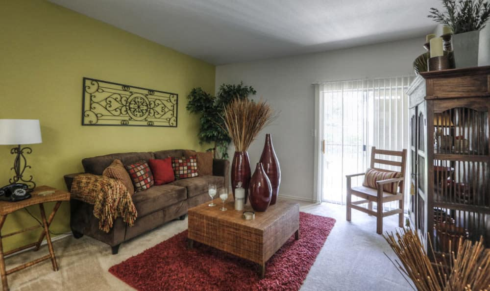 Living room with sliding door at Stone Creek Apartments
