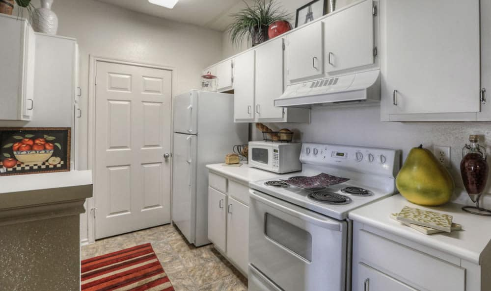 Kitchen with many appliances at Stone Creek Apartments