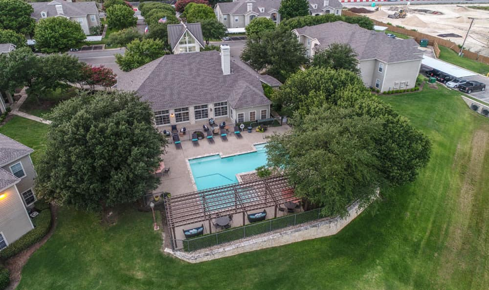 Aerial view of swimming pool at Stone Creek Apartments