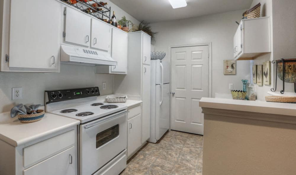 Kitchen with white cabinetry at Stone Creek Apartments